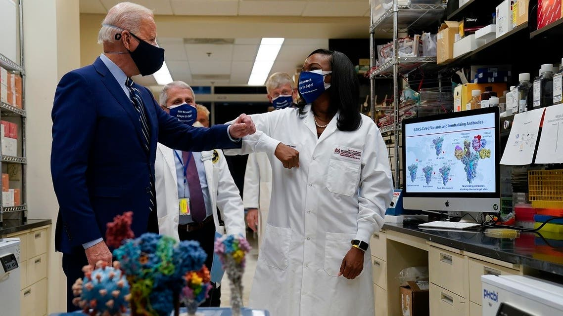 President Joe Biden greets Kizzmekia Corbett, an immunologist with the Vaccine Research Center at the National Institutes of Health (NIH), Feb. 11, 2021. (AP)
