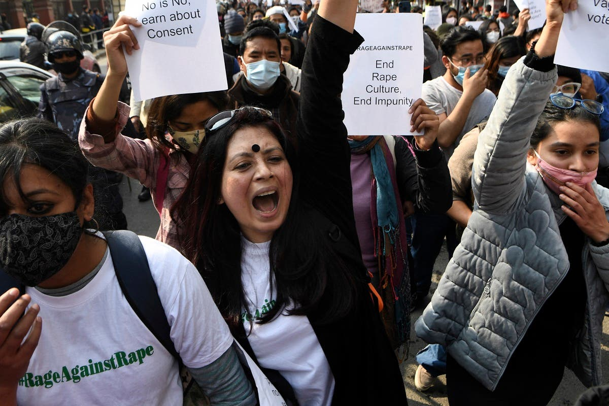 Demonstrators shout slogans during a protest rally against rape and the increasing cases of violence on women, in Kathmandu on February 12, 2021. (AFP)