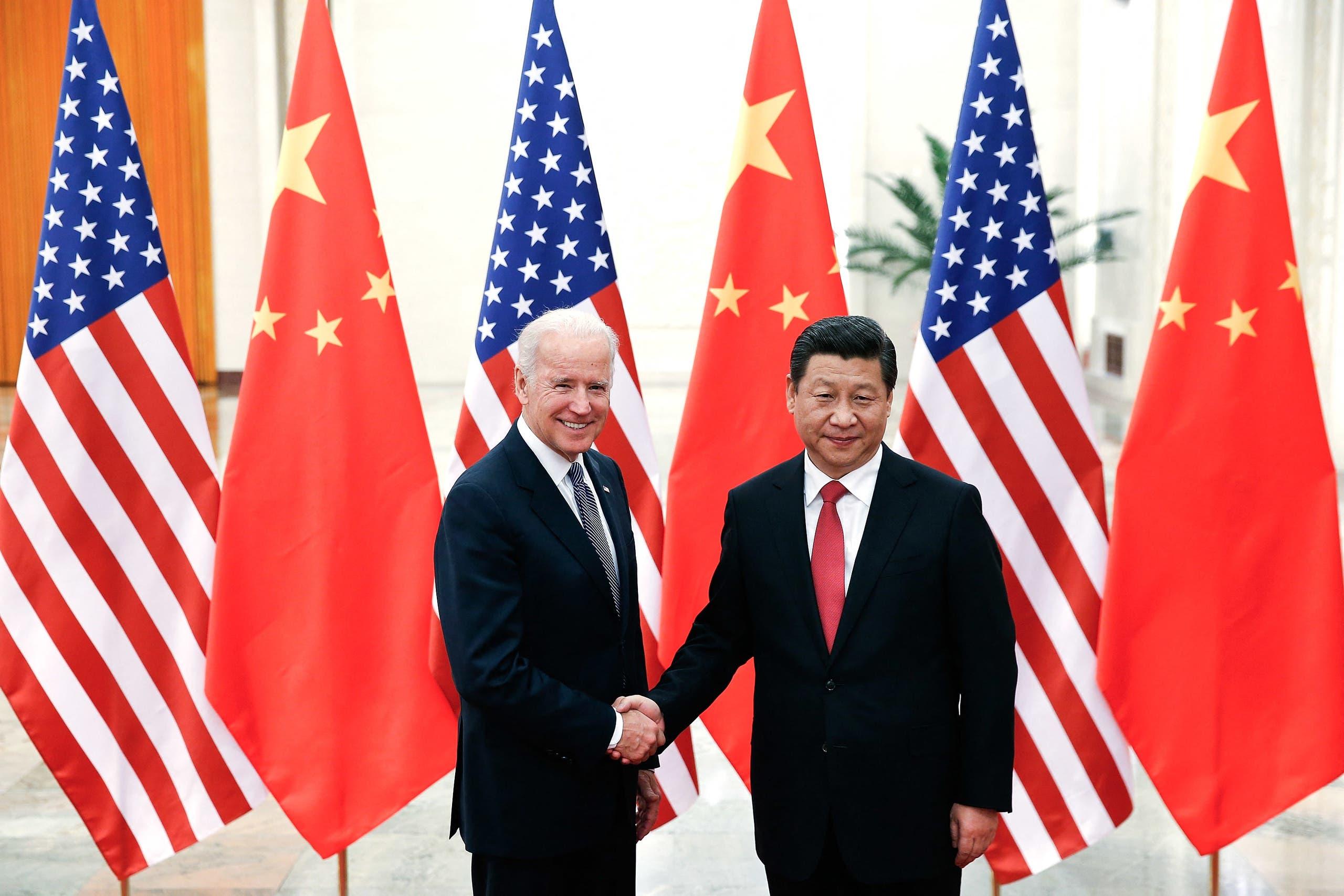 لقاء في ديسمبر 2013 في بكين بين شي جين بينغ وبايدن حين كان نائباً لأوباما