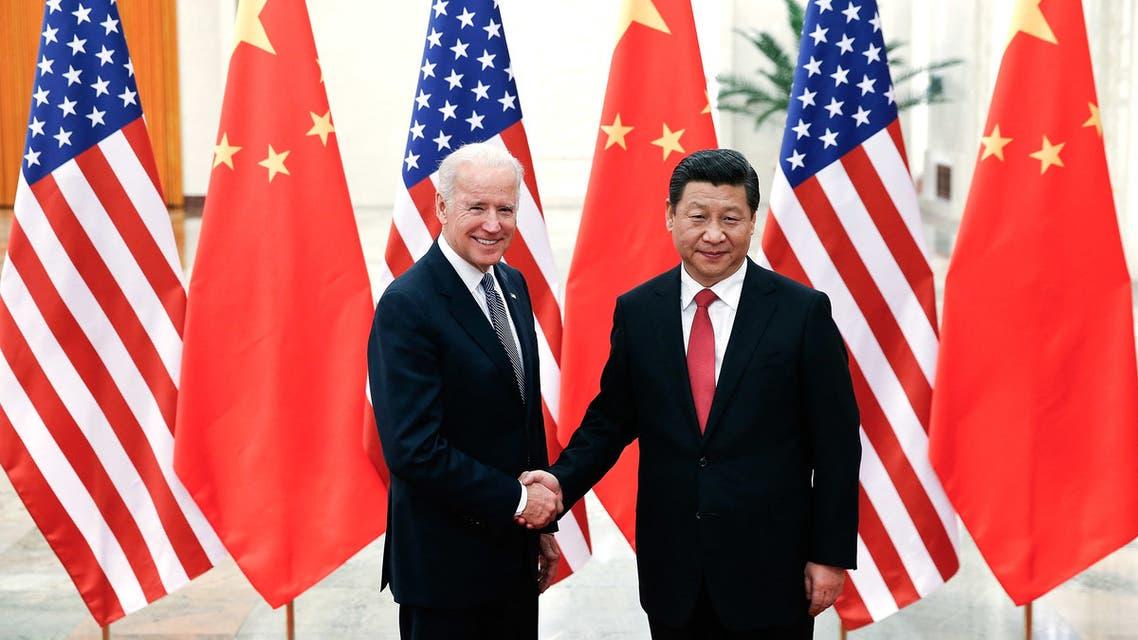 Chinese President Xi Jinping shakes hands with then-VP Joe Biden in Beijing, Dec. 4, 2013. (File Photo: Reuters)