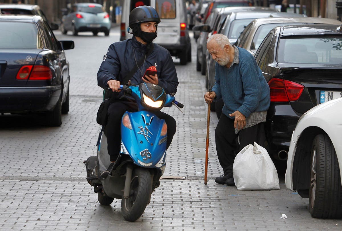 An elderly man uses a stick to walk, during a lockdown to curb the spread of the coronavirus disease in Beirut, Feb. 3, 2021. (Reuters)