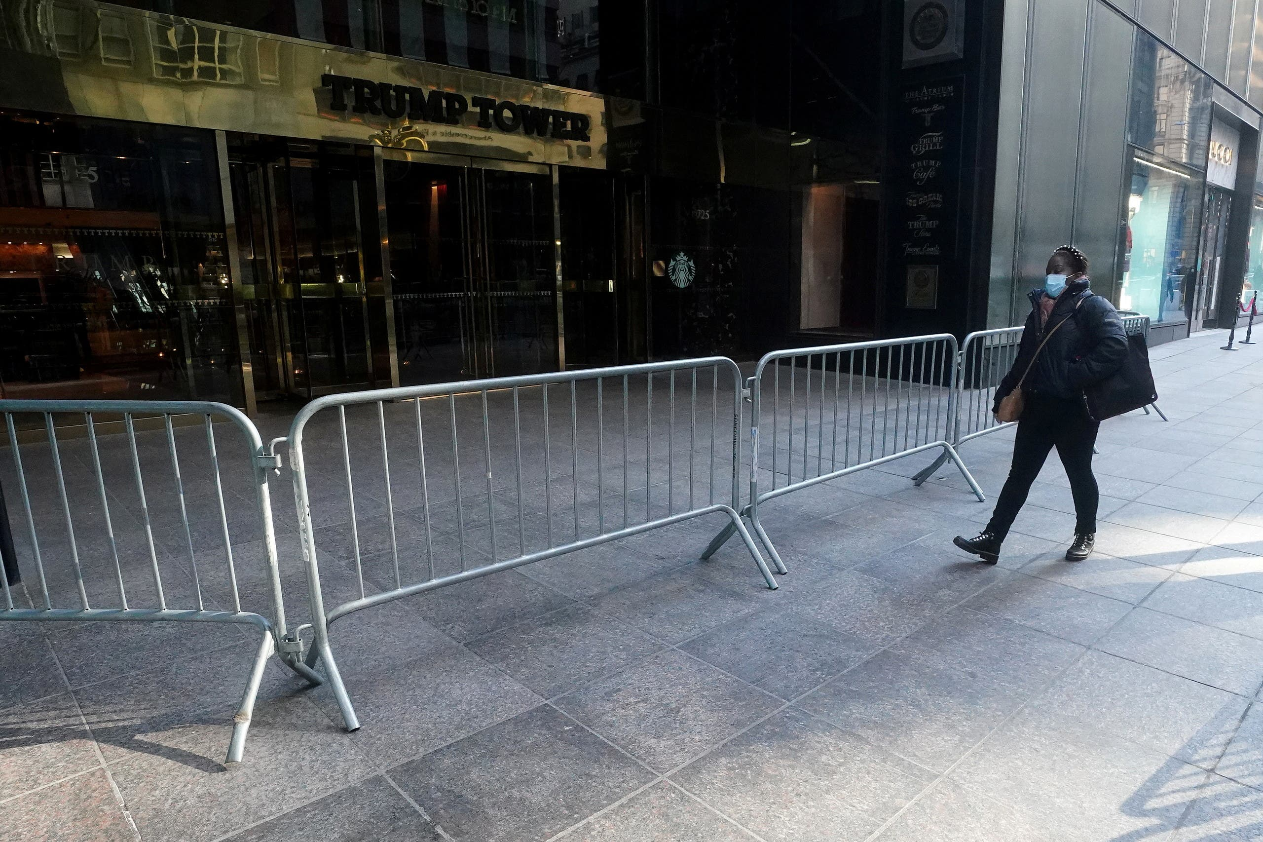 A person walks on the sidewalk outside Trump Tower amid the coronavirus disease (COVID-19) pandemic in the Manhattan borough of New York City, New York, U.S., January 12, 2021. (Reuters)