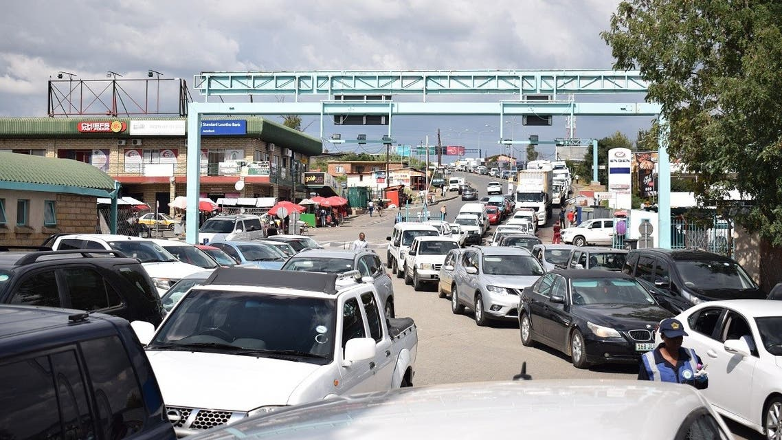 A queue of cars at the Maseru Bridge border post between Lesotho and South Africa on March 24, 2020, after South African President Cyril Ramaphosa announced national lockdown to curb the spread of coronavirus. (Molise Molise/AFP)