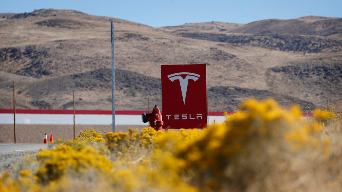 FILE - In this Oct. 13, 2018 file photo, a sign marks the entrance to the Tesla Gigafactory in Sparks, Nev. Tesla CEO Elon Musk solved a mystery involving a 27-year-old Russian who prosecutors say flew to the United States to offer a major-company insider $1 million to assist in a ransomware extortion attack on the firm. According to the billionaire, the scheme took aim at the electric car company's 1.9 million-square-foot factory in Sparks, Nevada, which makes batteries for Tesla vehicles and energy storage units. (AP Photo/John Locher, File)