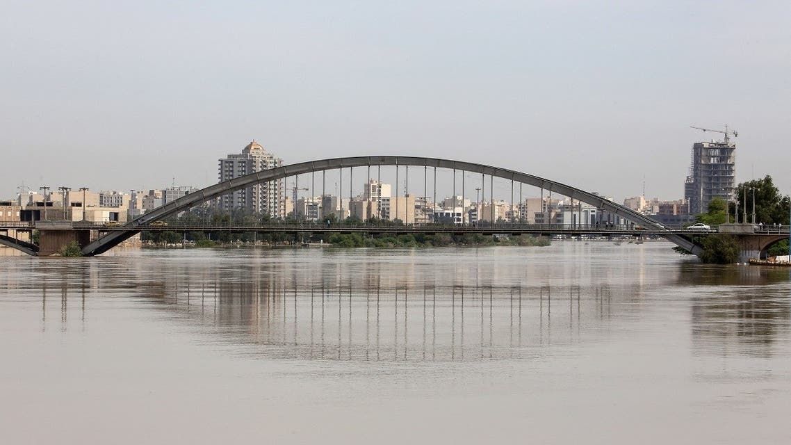 This picture taken on April 11, 2019 shows the Karun River which has burst its banks in Ahwaz, the capital of Iran's southwestern province of Khuzestan. (AFP)