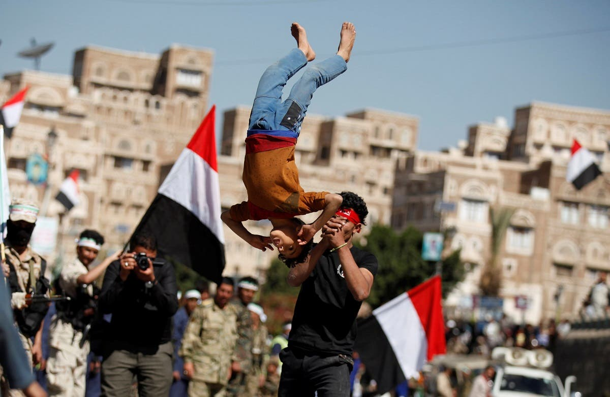 A boy displays skills during a parade held by newly recruited Houthi fighters before the fighters head to the frontline to fight against government forces, in Sanaa. (Reuters)