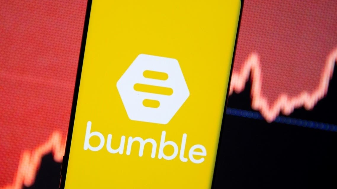 The Bumble logo is seen on a smartphone in front of a stock graph in this illustration. (Reuters)