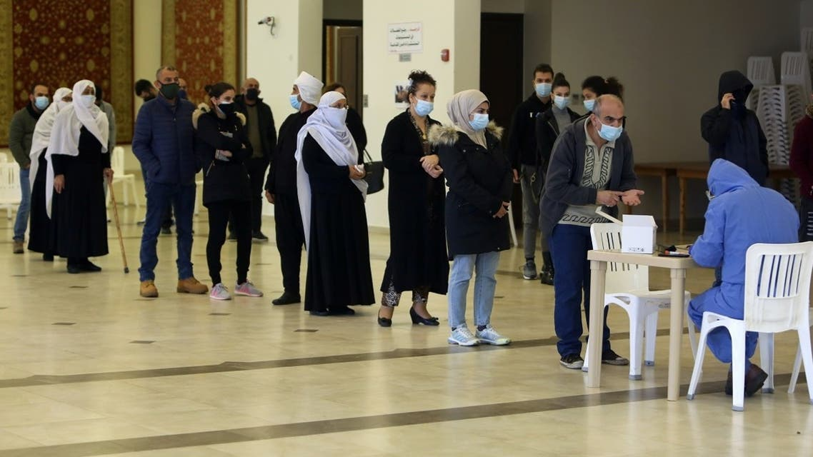 People wait in line to get tested for the coronavirus disease (COVID-19) in the town of Hasbaya, Lebanon, January 16, 2021. (Reuters/Aziz Taher)
