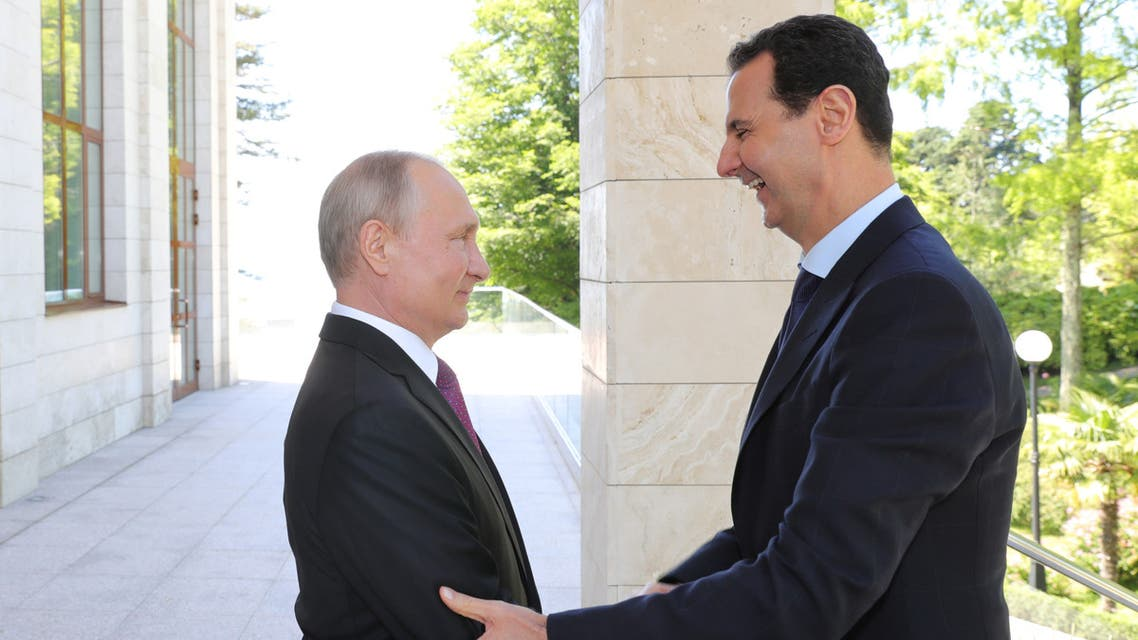 Russian President Vladimir Putin welcomes Syrian President Bashar al-Assad during their meeting in the Black Sea resort of Sochi, Russia May 17, 2018. Sputnik/Mikhail Klimentyev/Kremlin via REUTERS ATTENTION EDITORS - THIS IMAGE WAS PROVIDED BY A THIRD PARTY. TPX IMAGES OF THE DAY