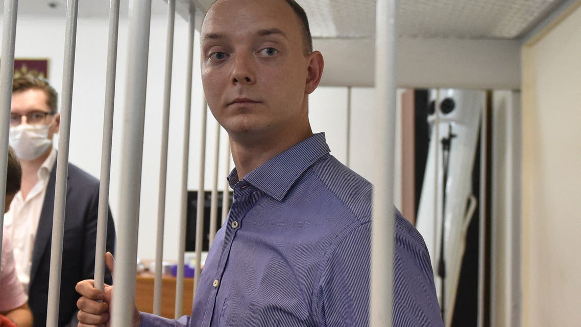 Ivan Safronov, a former journalist and aide to the head of Russia's space agency Roscosmos, detained on charges of treason for divulging state military secrets, stands inside a defendants' cage during a court hearing in Moscow on July 7, 2020. (AFP)
