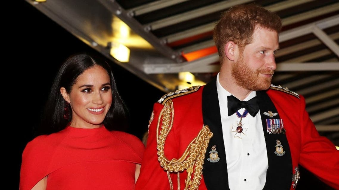 Britain's Prince Harry, Duke of Sussex and Meghan, Duchess of Sussex arrive to attend The Mountbatten Festival of Music at the Royal Albert Hall in London on March 7, 2020. (AFP)