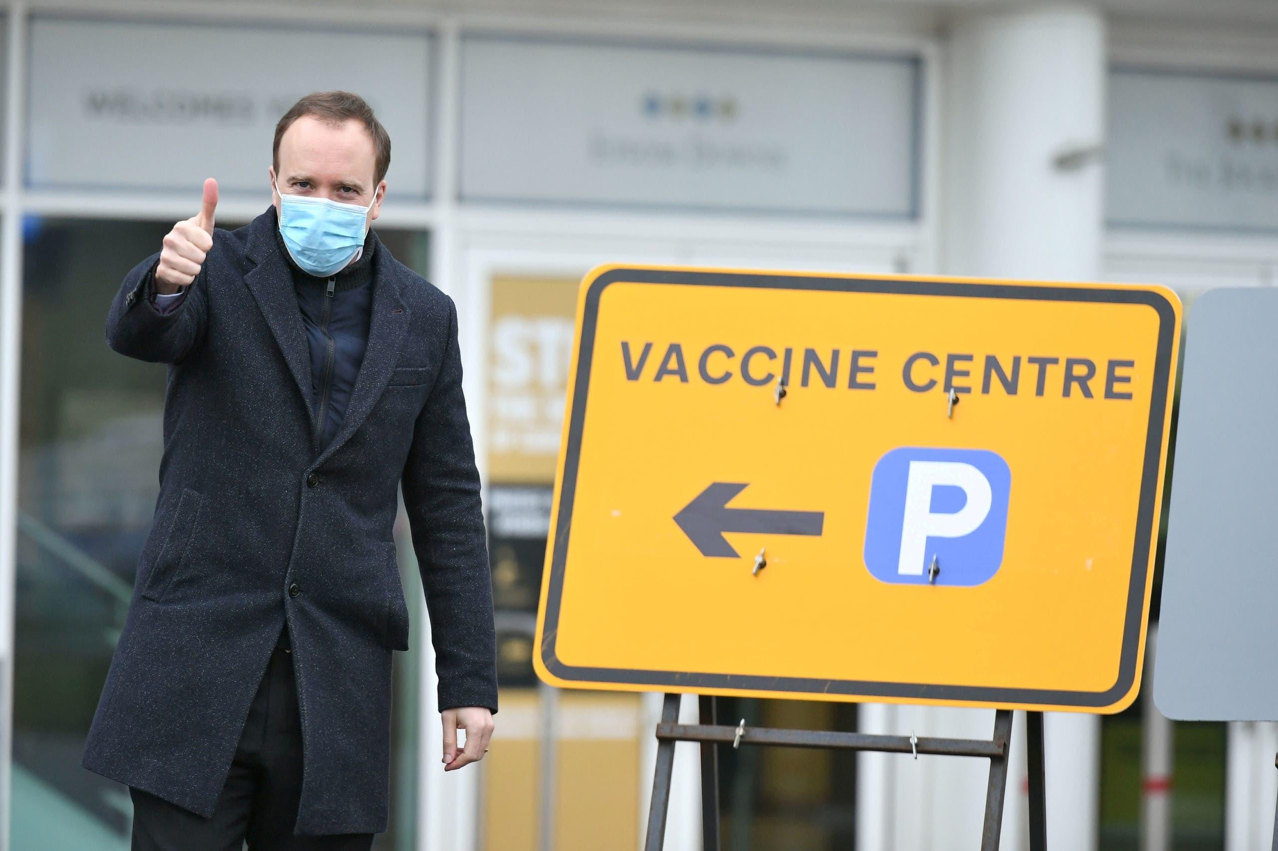 Britain's Health Secretary Matt Hancock visits a NHS mass coronavirus vaccination centre at Epsom Race Course in Epsom, Surrey, Britain January 11, 2021. (Reuters)