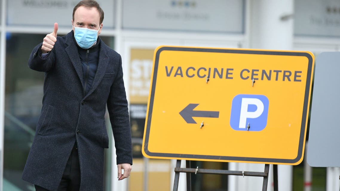 Britain's Health Secretary Matt Hancock visits a NHS mass coronavirus vaccination centre at Epsom Race Course in Epsom, Surrey, Britain January 11, 2021. (Reuters)