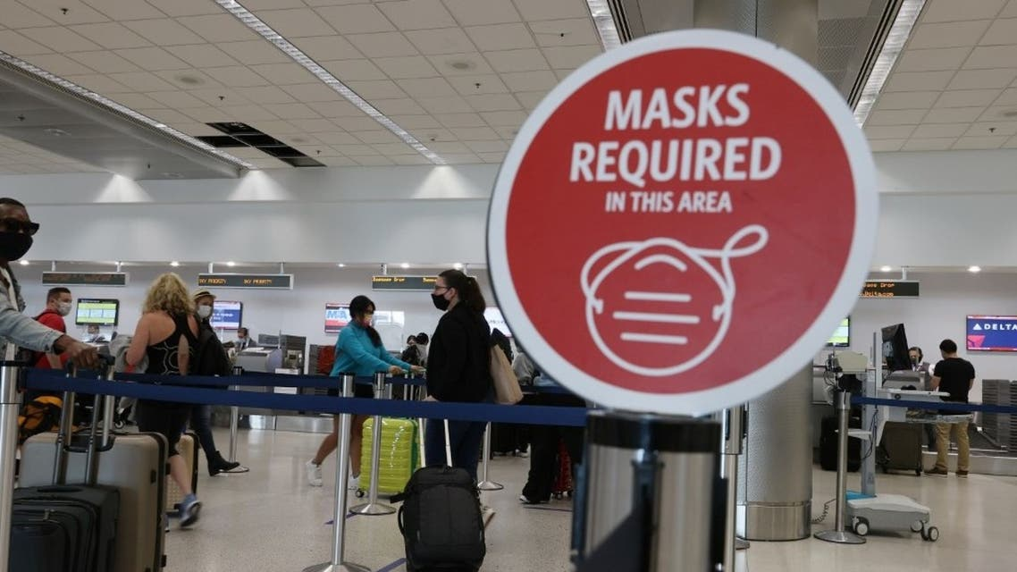 A sign reading, 'masks required in this area,' is seen at the Miami International Airport on February 01, 2021 in Miami, Florida. (AFP)