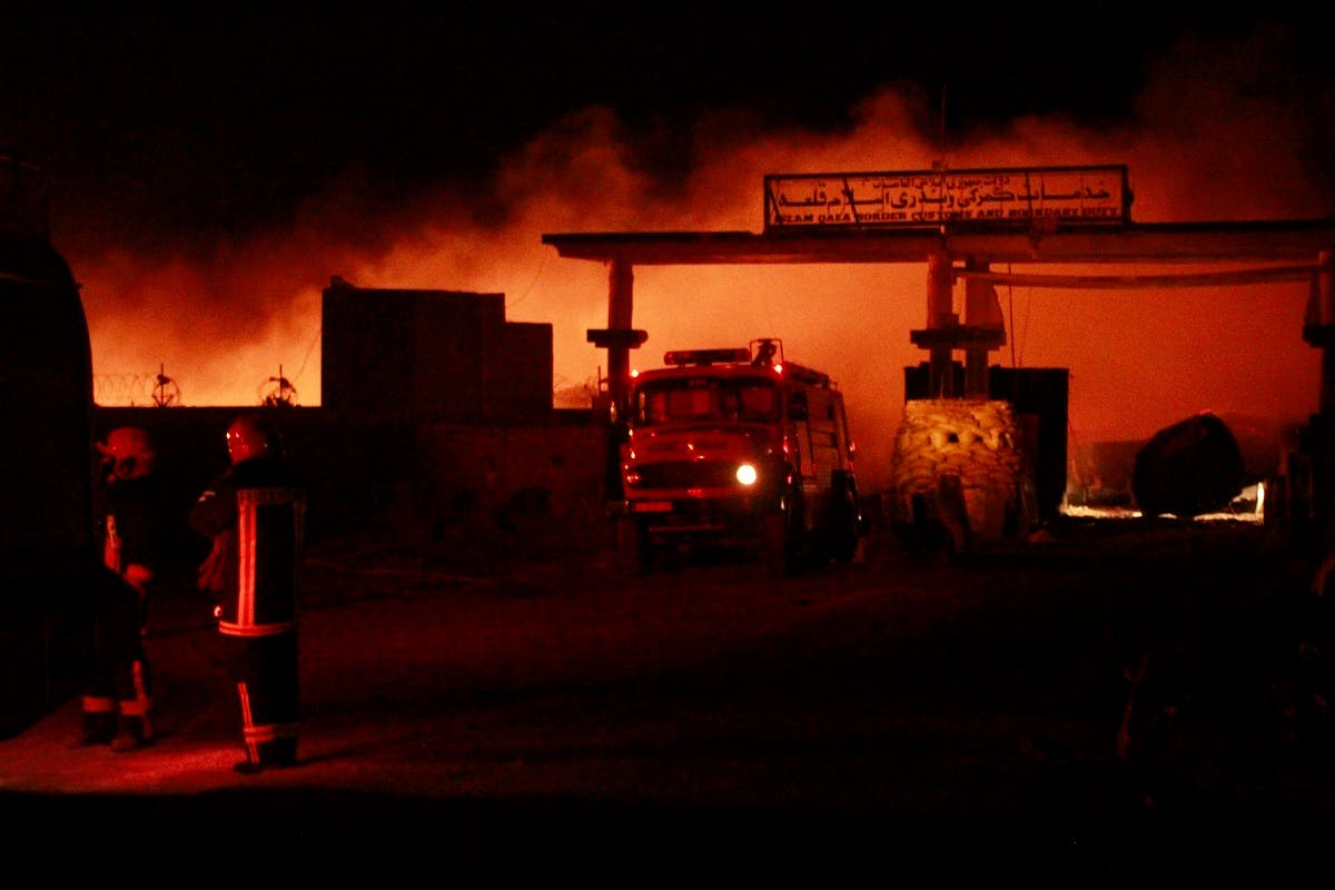 Iranian firefighters work on a burning tanker carrying fuel at the Islam Qala border with Iran, in Herat Province, west of Kabul, Afghanistan, Saturday, on February 13, 2021. (AP)