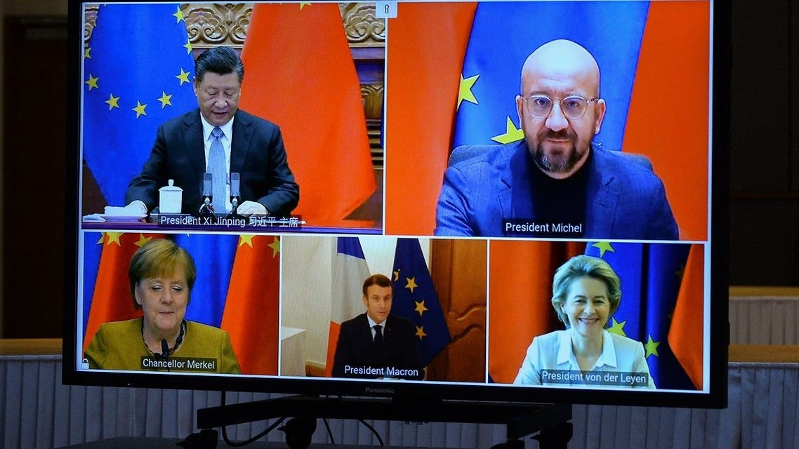 EU leaders and Chinese President Xi Jinping are seen on a screen during a video conference to approve an investment December 30, 2020 in Brussels, Belgium. (Johanna Geron/AFP)