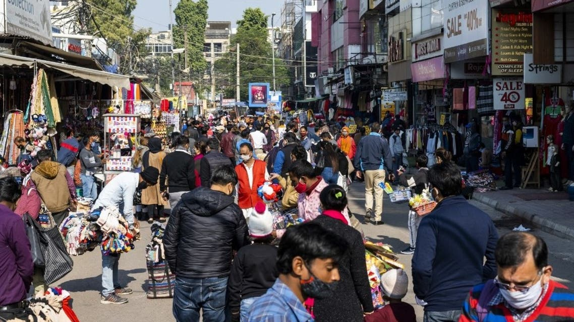Shoppers gather at a market area in New Delhi on December 19, 2020, as India surged past 10 million coronavirus cases. (AFP)