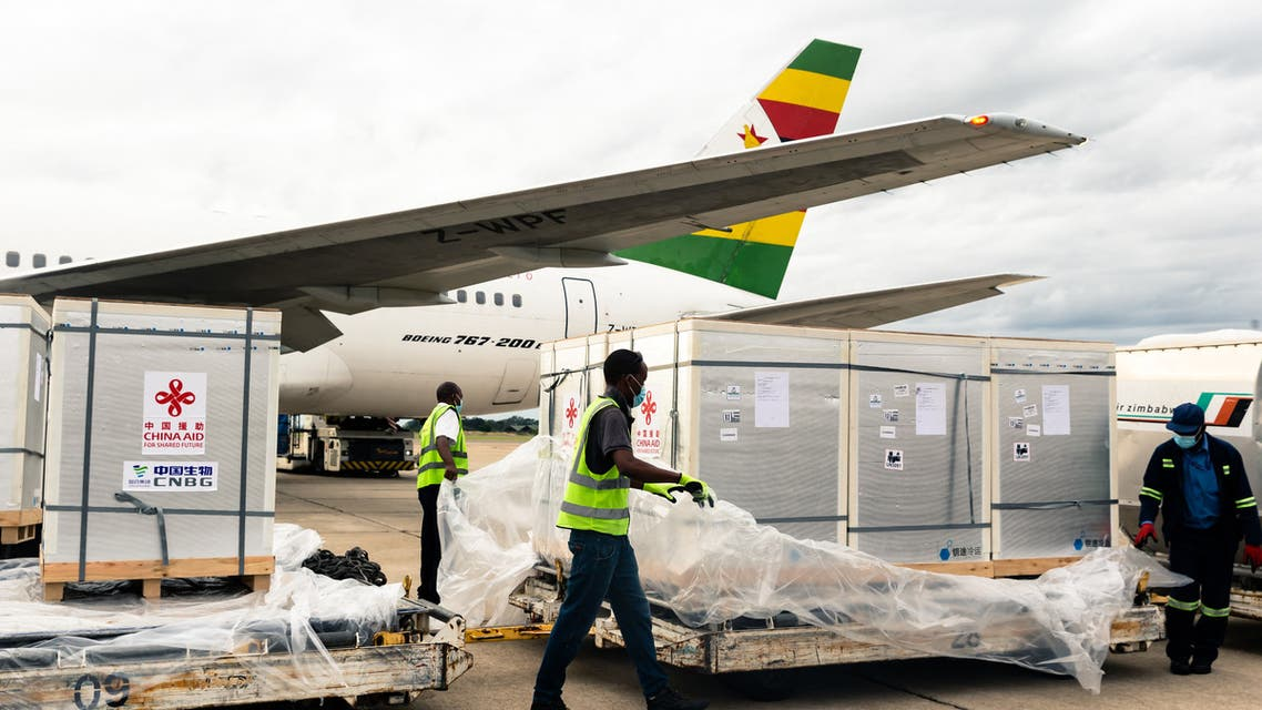 Workers offload part of a consignment of 200,000 doses of the Sinopharm coronavirus vaccine from China off an Air Zimbabwe aeroplane which has just landed on February 15, 2021 at the Robert Mugabe International Airport. (AFP)