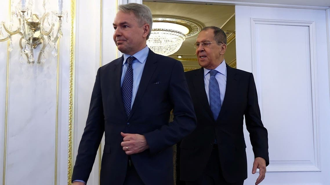 Russia's Foreign Minister Sergei Lavrov and his Finnish counterpart Pekka Haavisto walk during a meeting in Saint Petersburg, Russia, on February 15, 2021. (Reuters)