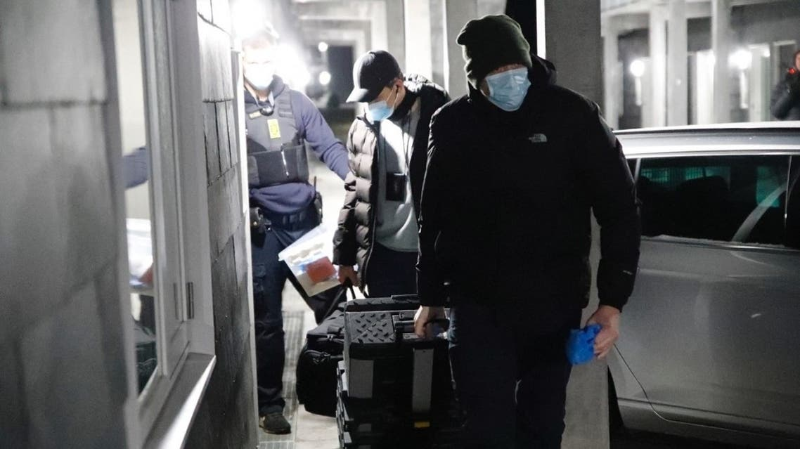 A picture taken on February 6, 2021 shows Danish police officers and forensic technicians in Apotekerhaven in Holbaek. (Stringer/presse-fotos.dk/Ritzau Scanpix/AFP)