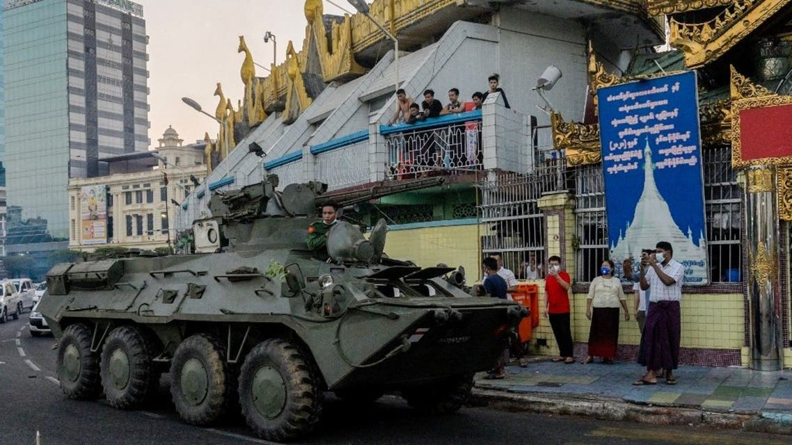 An armoured vehicle drives next to the Sule Pagoda, following days of mass protests against the military coup, in Yangon on February 14, 2021. (AFP)