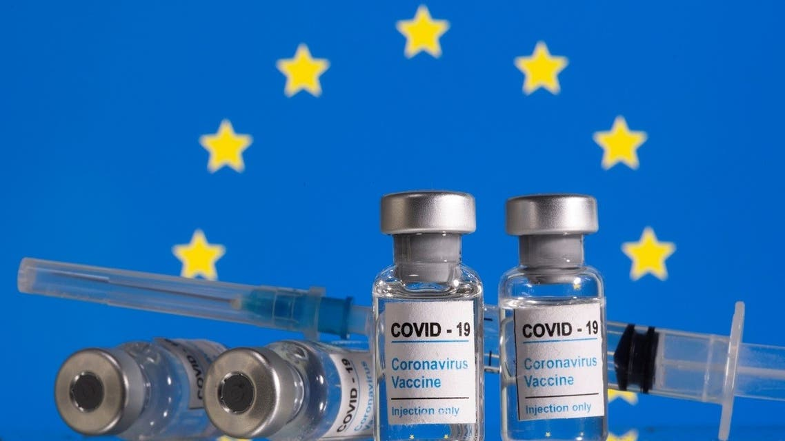 ials labelled COVID-19 Coronavirus Vaccine and sryinge are seen in front of displayed EU flag in this illustration taken, February 9, 2021. REUTERS
