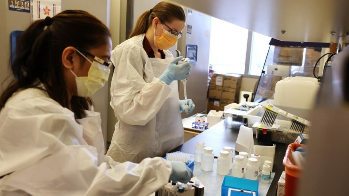 Medical lab scientists work on samples collected in the Novavax phase 3 Covid-19 clinical vaccine trial on February 12, 2021 in Seattle, Washington. (AFP)