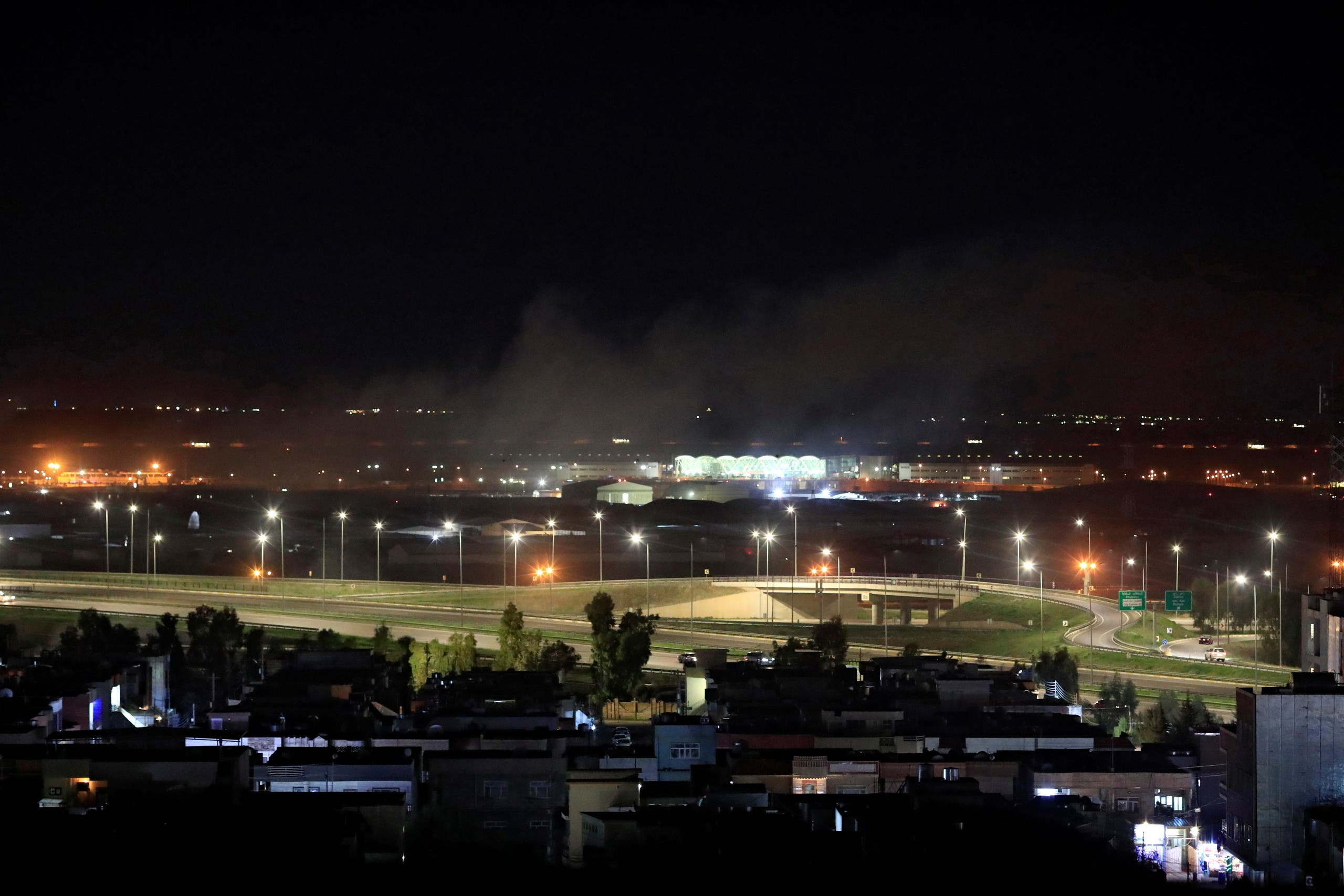 Smoke rises over the Erbil, after reports of mortar shells landing near Erbil airport, Iraq February 15, 2021. (Reuters)