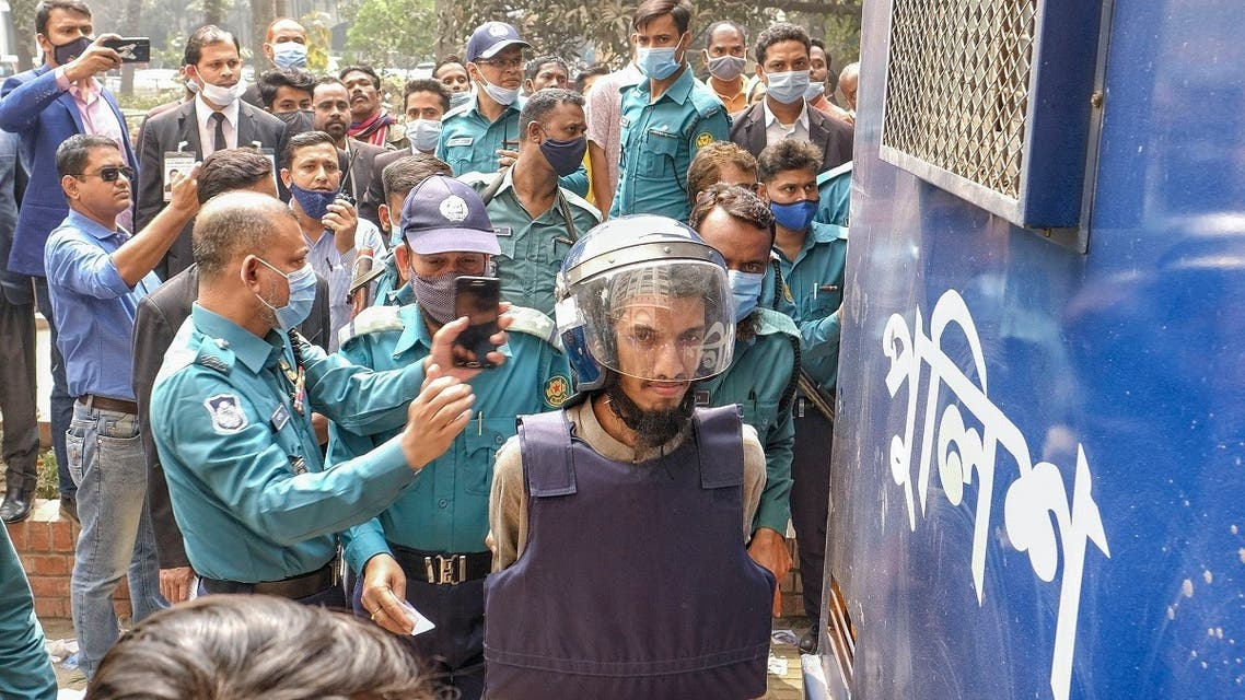 Mozammel Hossain, wearing bullet proof jacket and helmet, one among those convicted in the 2015 killing of Bangladeshi-American blogger Avijit Roy, is brought to the Anti-Terrorism Special Tribunal in Dhaka, Bangladesh, February 16, 2021. (AP/Mahmud Hossain Opu)