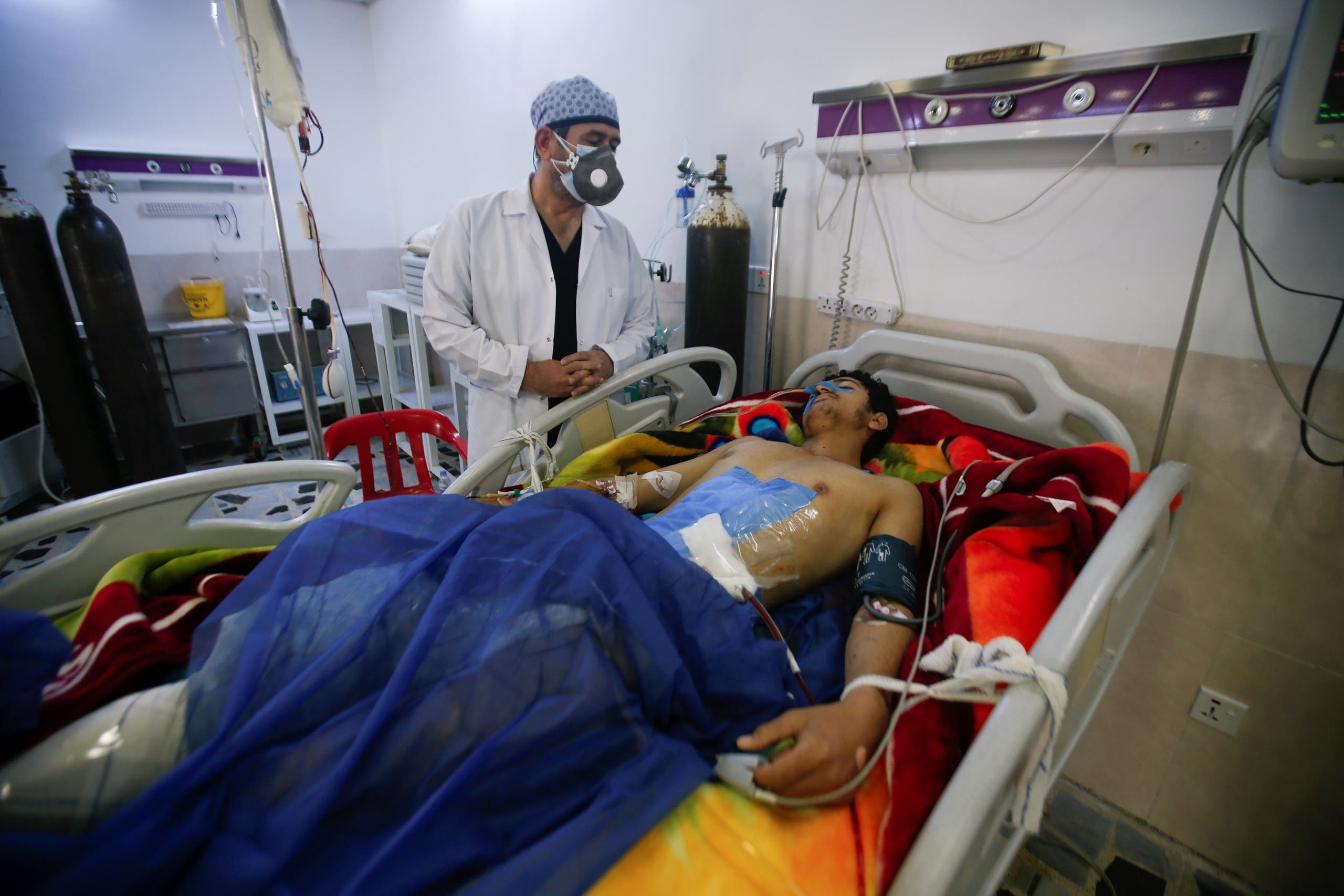 A man is treated at a hospital after he was injured during a rocket attack on U.S.-led forces in and near Erbil International Airport, in Erbil. (Reuters)