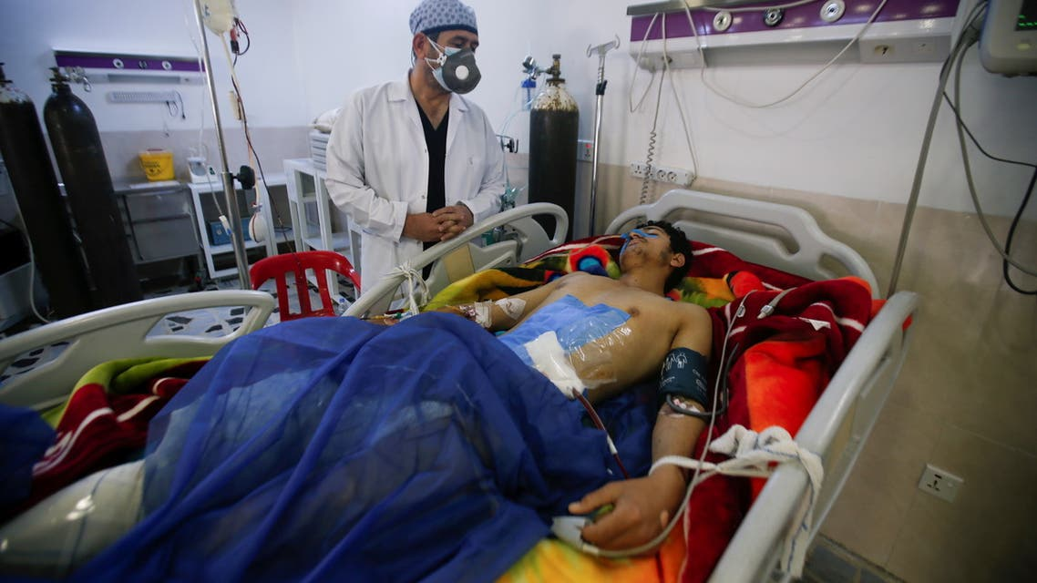 A man is treated at a hospital after he was injured during last night's rocket attack on U.S.-led forces in and near Erbil International Airport, in Erbil, Iraq February 16, 2021. REUTERS/Azad Lashkari