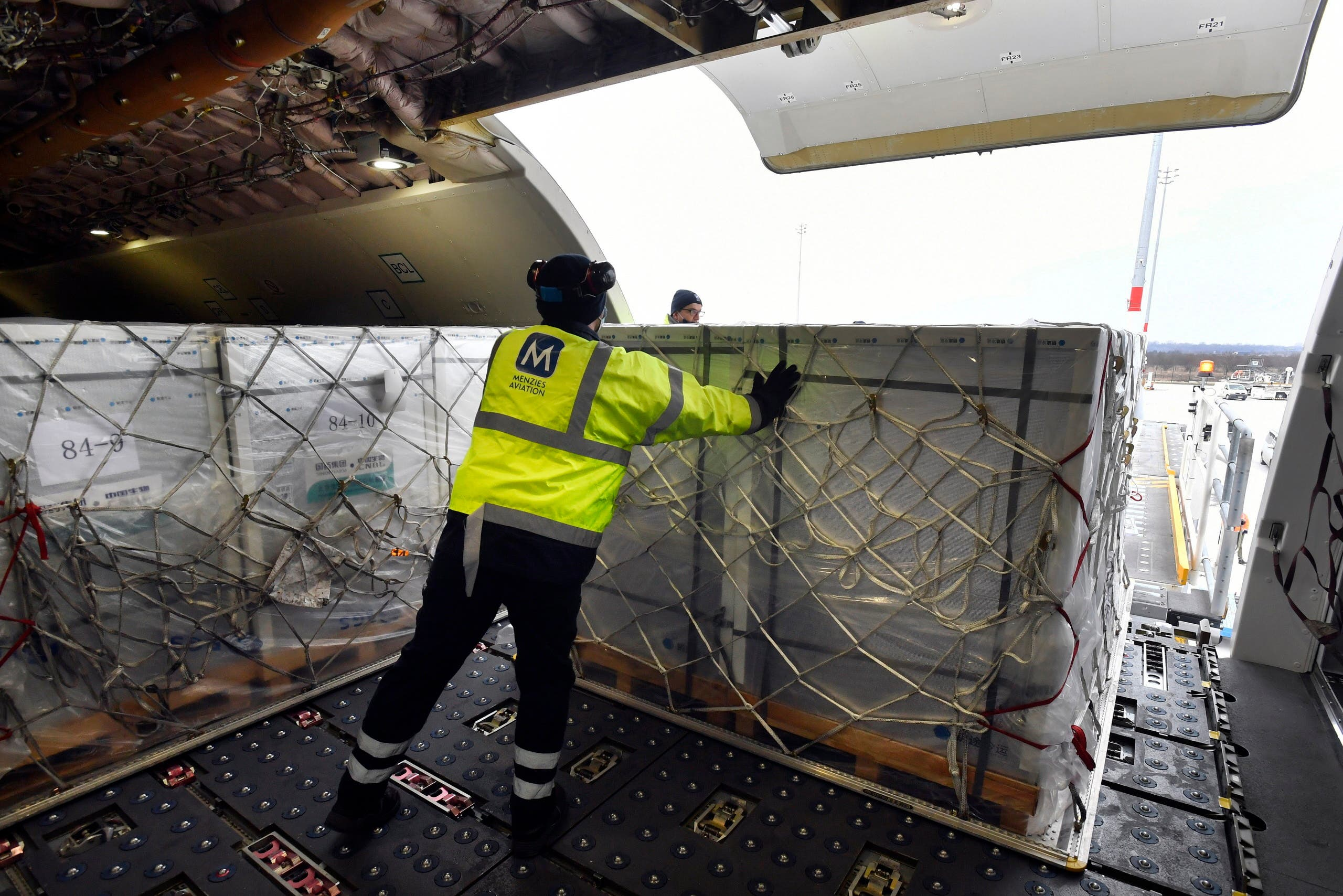 A box containing vaccines is unloaded from a Hungarian Airbus 330 cargo plane as the first batch of the vaccine against the new coronavirus produced by Sinopharm of China arrives at Budapest Liszt Ferenc International Airport in Budapest, Hungary, Tuesday, February 16, 2021. (AP)