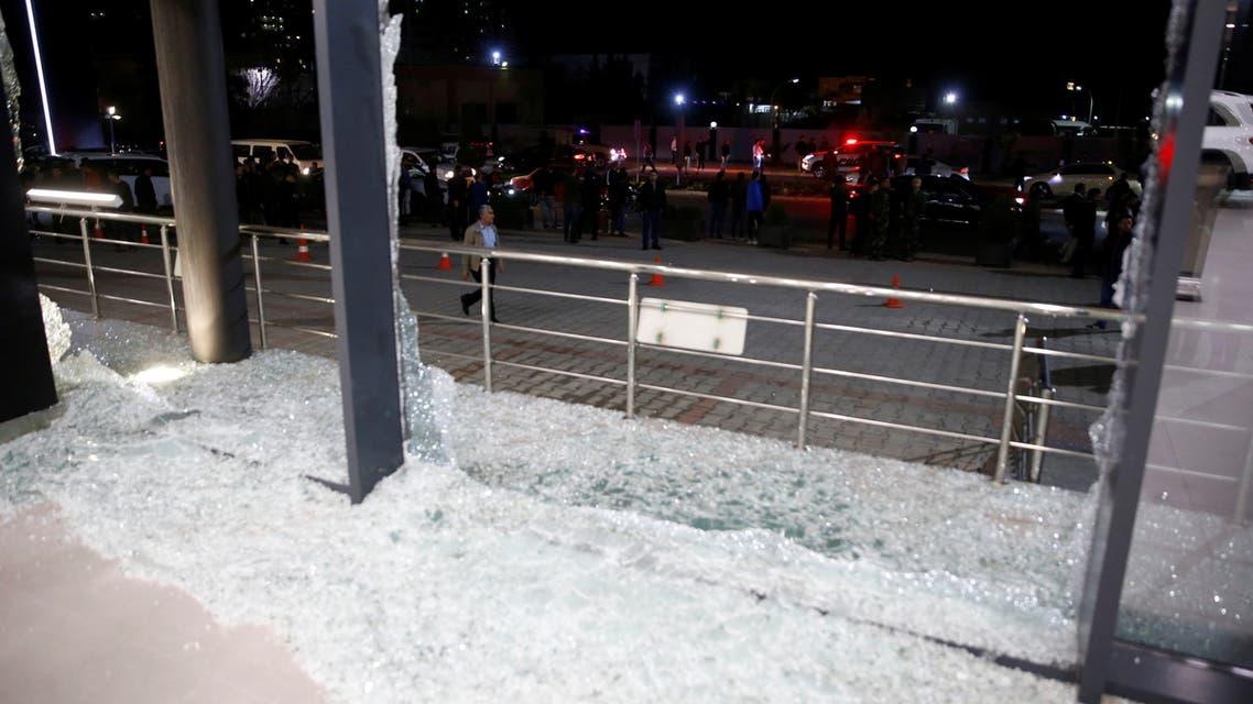 Broken glass is seen at the Bright Castle Motors building after reports of mortar shells landing near Erbil airport, in Erbil, Iraq February 15, 2021. REUTERS/Azad Lashkari