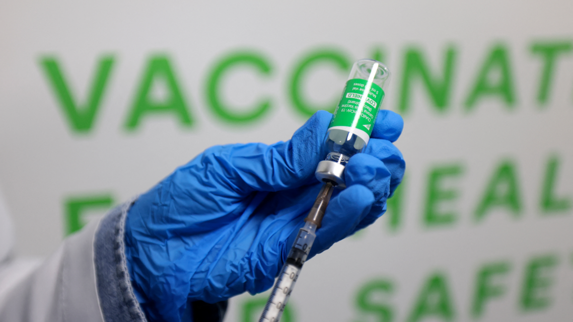 A health worker prepares an injection of the Oxford–AstraZeneca vaccine (Covishield) against the coronavirus at a vaccination centre set up at the Dubai International Financial Center in the Gulf emirate of Dubai, on February 3, 2021. (AFP)