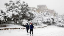 Ancient Acropolis covered in thick snow as cold spell hits Athens