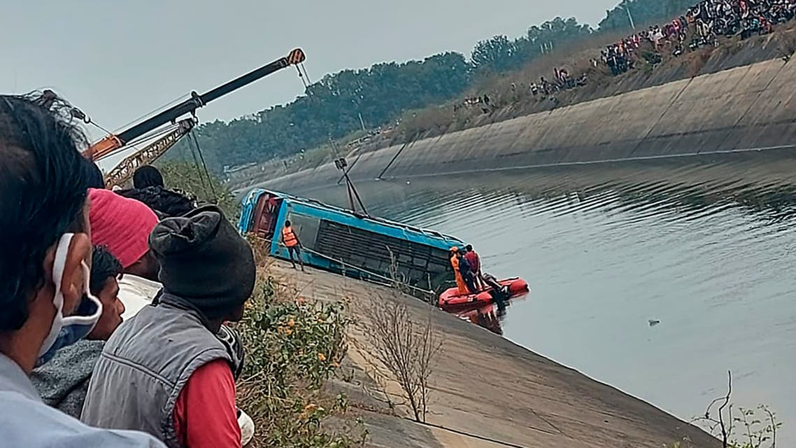 A bus that fell into a canal is pulled out in Sidhi district, in the central Indian state of Madhya Pradesh, Tuesday, Feb. 16, 2021. (Madhya Pradesh District Public Relation Office Sidhi via AP)