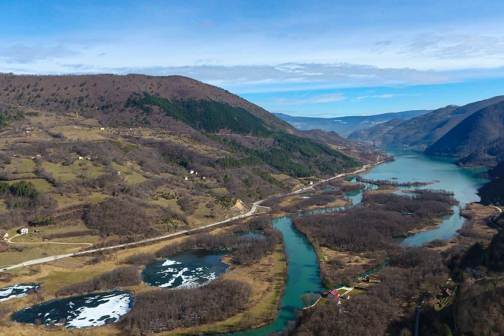 An aerial photograph shows the village of Jezero, Bosnia, Tuesday, February 16, 2021. (AP)