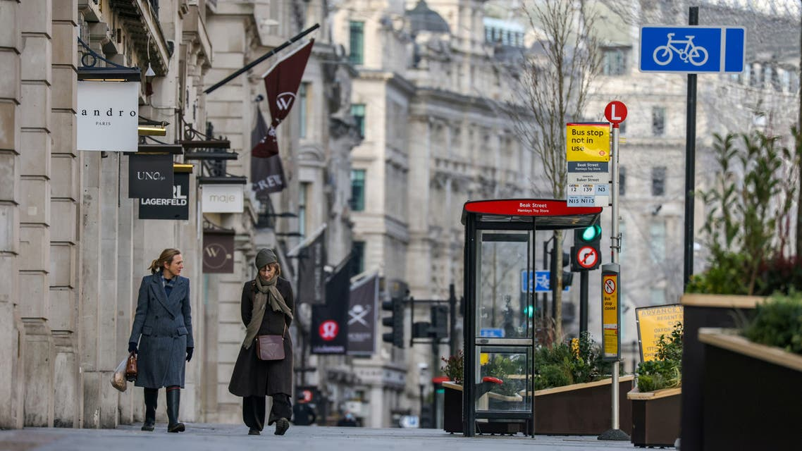 Two women walk down Regent Street, one of London's main shopping streets, as Britain continues its third COVID-19 lockdown, in London, Britain. (Reuters)