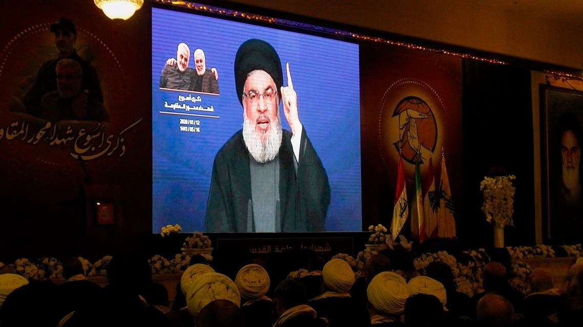 Hezbollah chief Hassan Nasrallah delivers a speech on a screen in the southern Lebanese city of Nabatieh, Jan 12, 2020. (AFP)