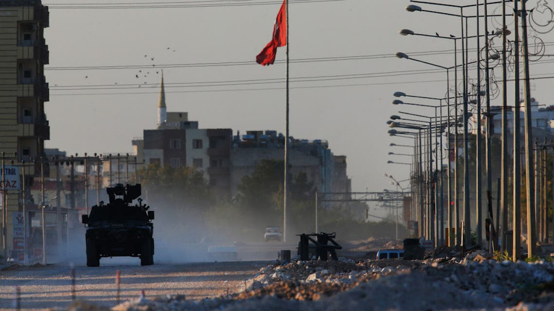 A Turkish police armored vehicle patrols the town of Akcakale, Sanliurfa province, southeastern Turkey, at the border with Syria, Saturday, Oct. 12, 2019. (AP)