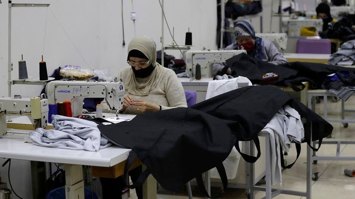 Seamstresses sew body bags for COVID-19 victims at al-Oum institution sewing factory in Saida south of Beirut on February 16, 2021. (Joseph Eid/AFP)