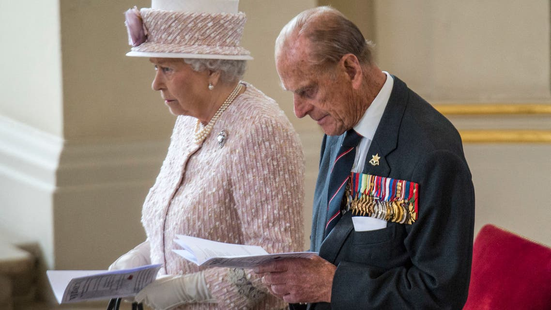Britain's Prince Phillip, Duke of Edinburgh and Britain's Queen Elizabeth II attend a Service of Commemoration at St Martin-in-the-Fields church in central London on August 15, 2015, to mark the 70th anniversary of VJ (Victory over Japan) Day. (AFP)