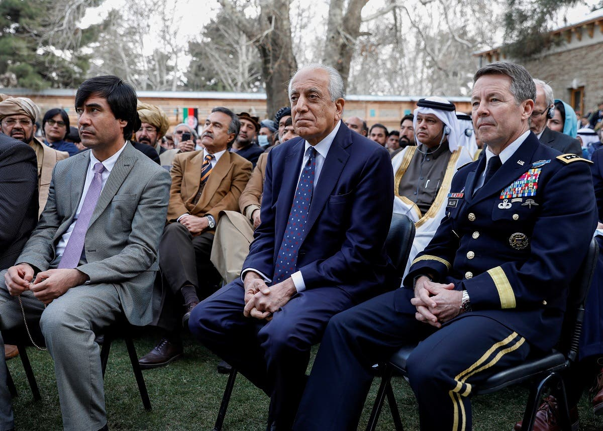 US envoy for peace in Afghanistan Zalmay Khalilzad (C) and US Army General Scott Miller, commander of NATO's Resolute Support Mission and United States Forces in Afghanistan, attend Afghanistan's President Ashraf Ghani's inauguration as president, in Kabul, Afghanistan, on March 9, 2020. (Reuters)
