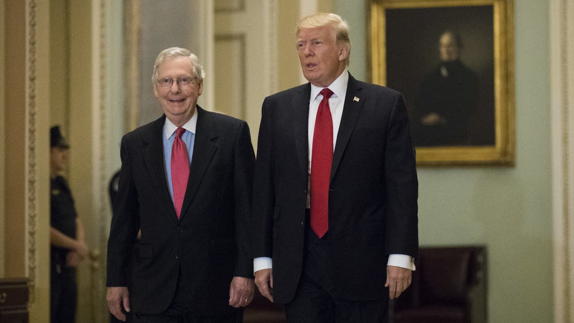 (FILES) In this file photo taken on October 23, 2017 President Donald Trump (R) and Senate Majority Leader Mitch McConnell (R-KY) walk to a lunch with Senate Republicans on Capitol Hill, October 24, 2017 in Washington, DC. Donald Trump urged Republican senators February 16, 2021 to dump Mitch McConnell as their leader in the Senate following his withering criticism of the former US president after his impeachment trial.