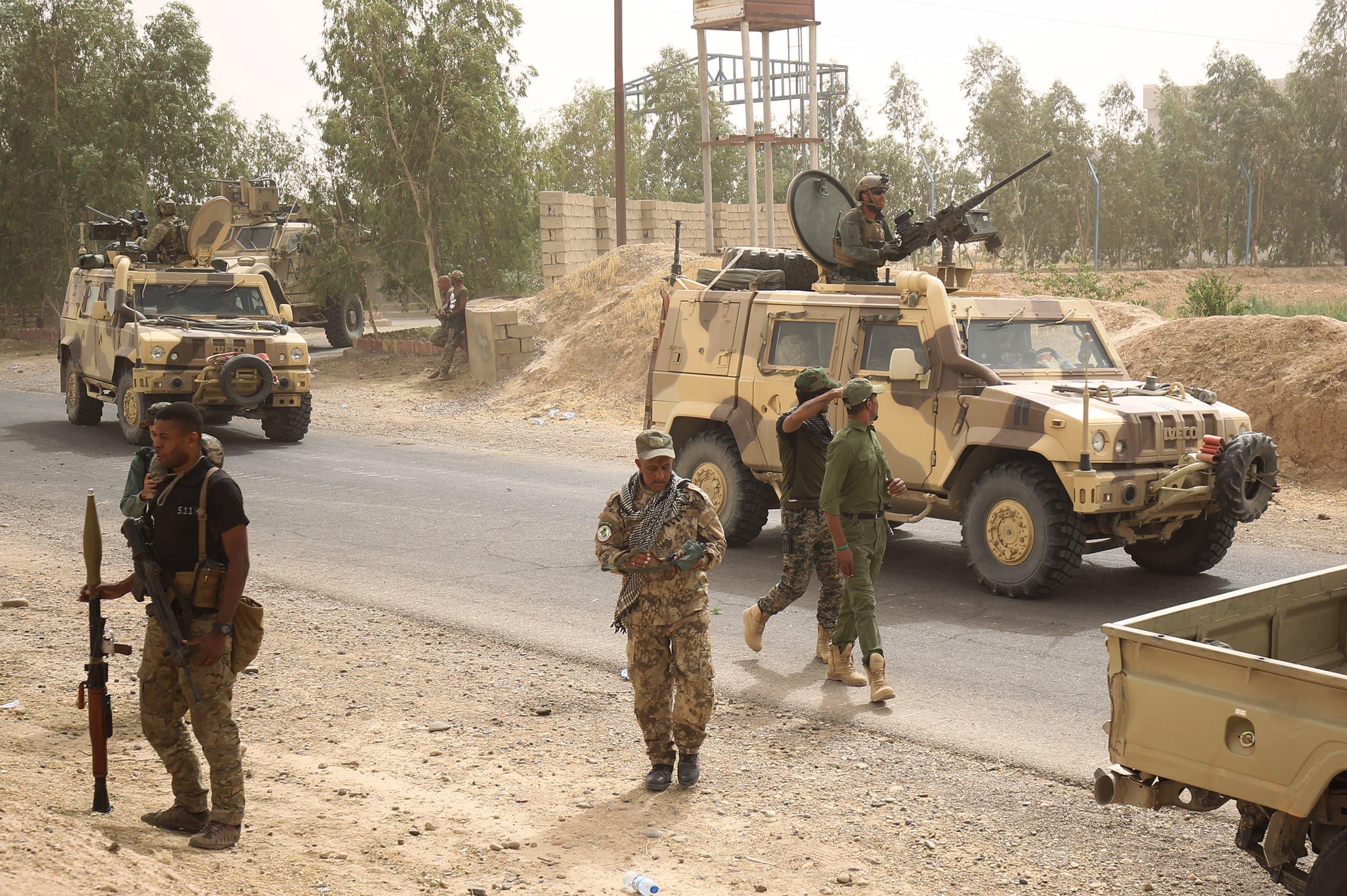 آليات للجيش العراقي وأخرى للتحالف في الحويجة (أرشيفية)