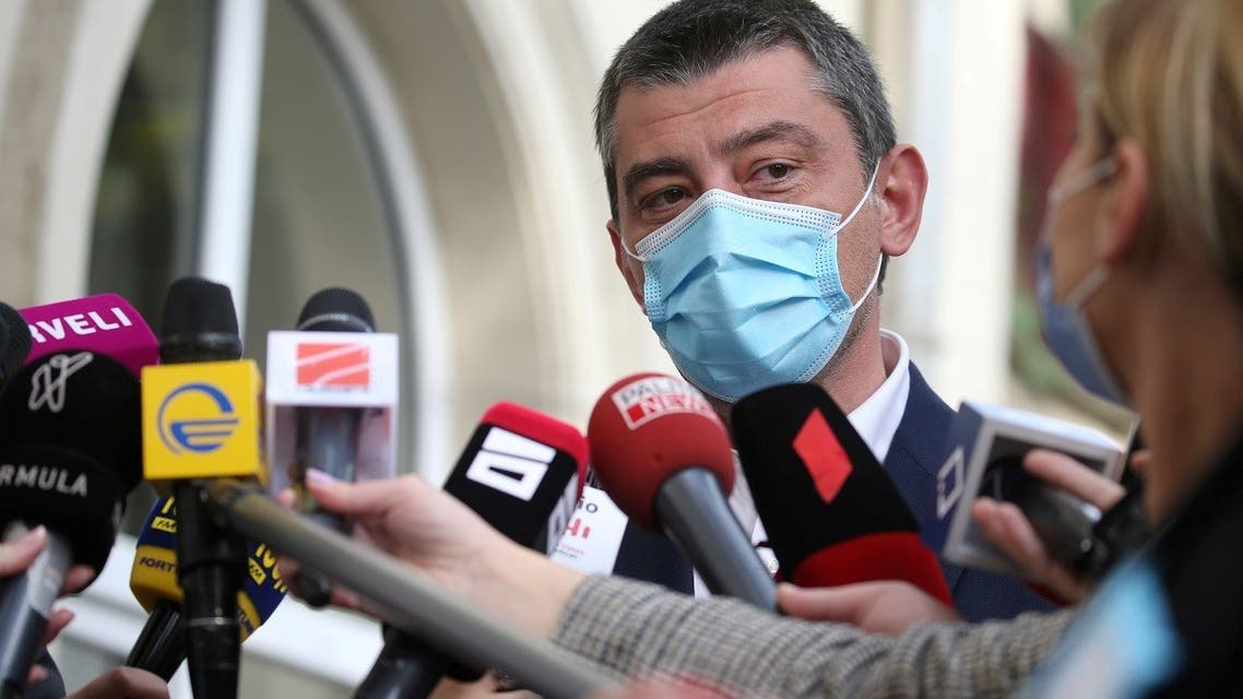 Georgia's Prime Minister Giorgi Gakharia speaks to the media as he visits a polling station during a parliamentary election in Tbilisi, Georgia October 31, 2020. (Reuters)