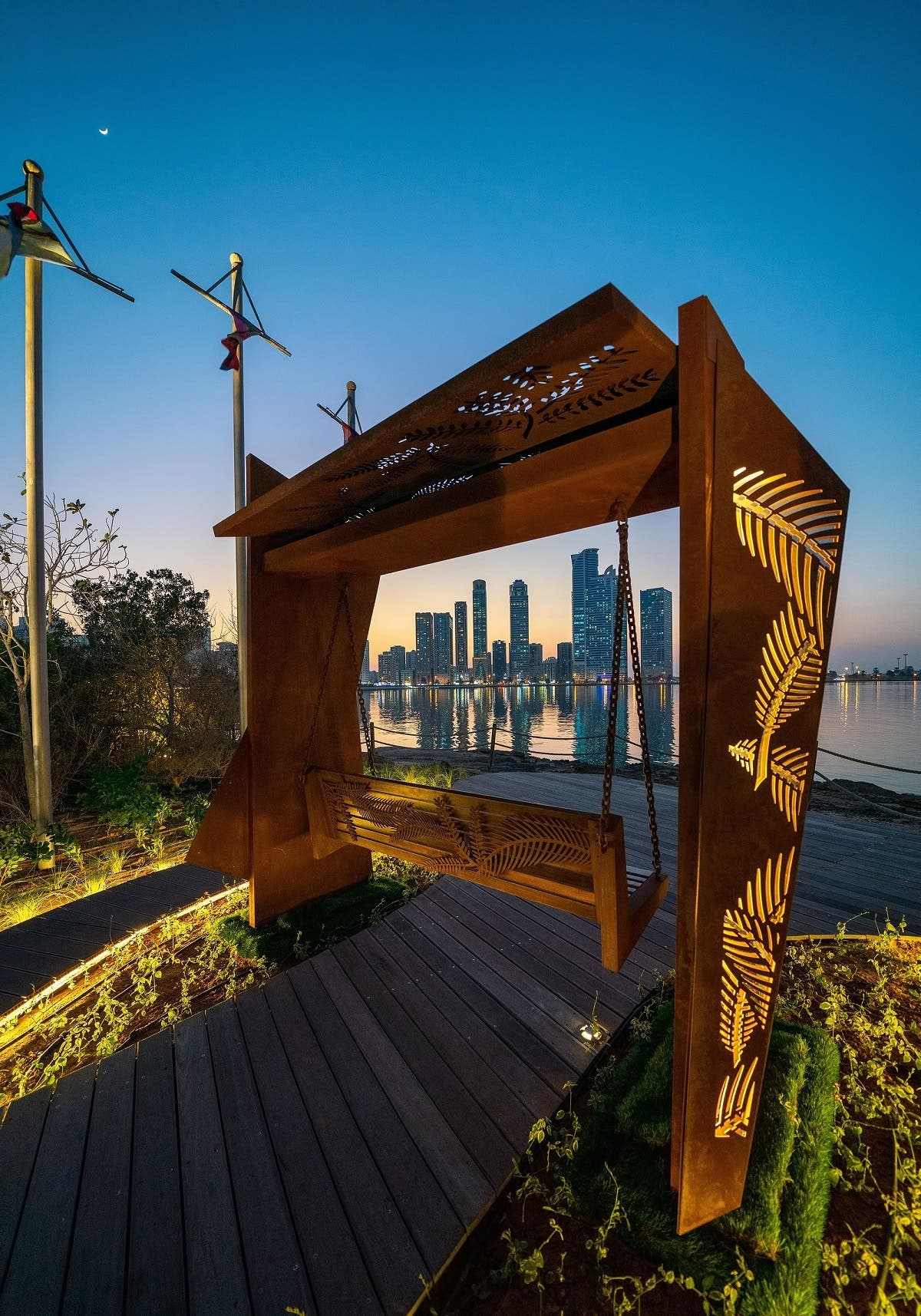 Shaped by seven abstract pieces of rusted mild steel and stainless steel, with Ghaf and palm tree leaves cut on them, 'The Swing' features immersive and sustainable art that reflects the past and the present of the UAE.  (Supplied)