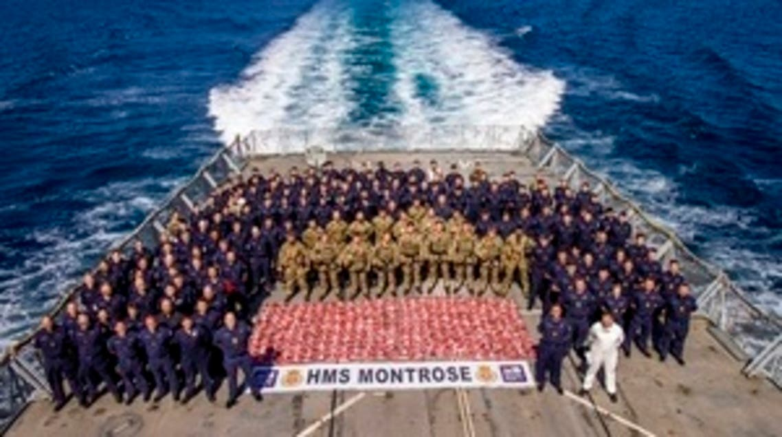 Royal Marines and sailors stand around the confiscated 2.4 tons of drugs. (File photo: UK MoD Crown)
