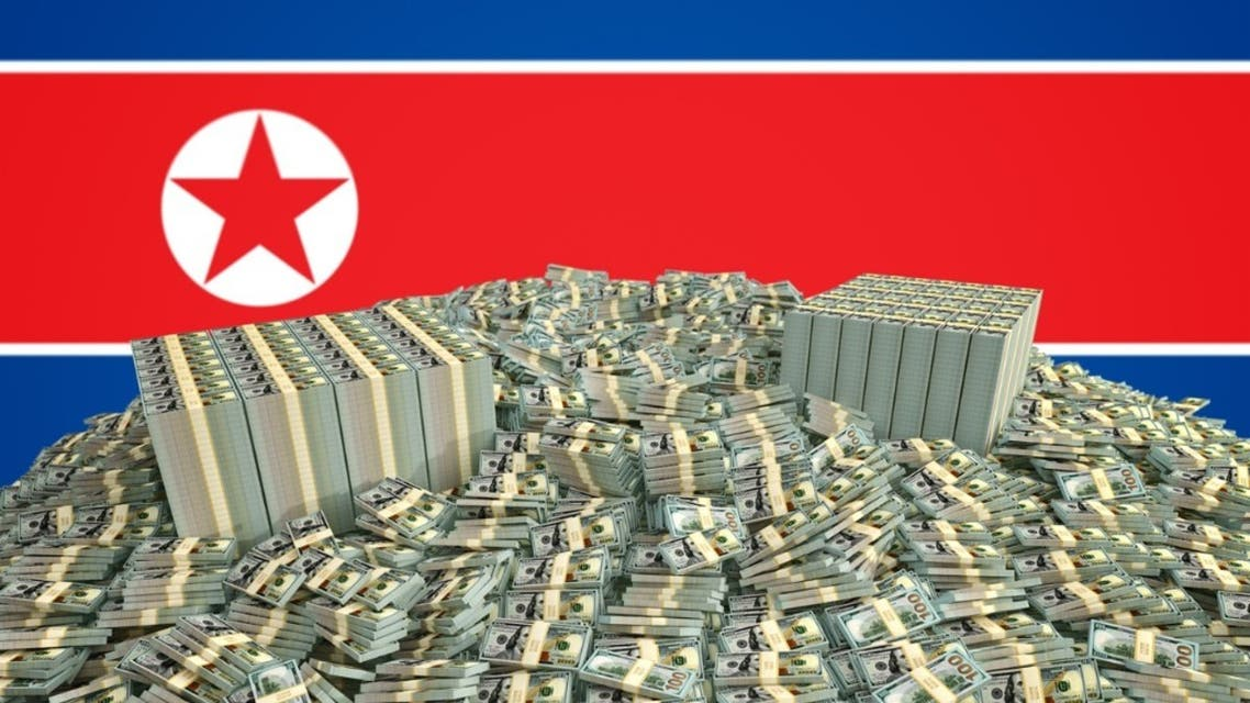 Millions of Dollars in front of the North Korea flag stock photo