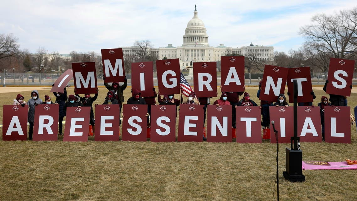 Demonstrators display a message along the National Mall during an immigrant essential workers rally near the U.S. Capitol in Washington, U.S., February 17, 2021. (Reuters)